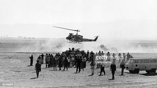 Bell Huey helicopter lands in the desert during the Israeli Arab conflict