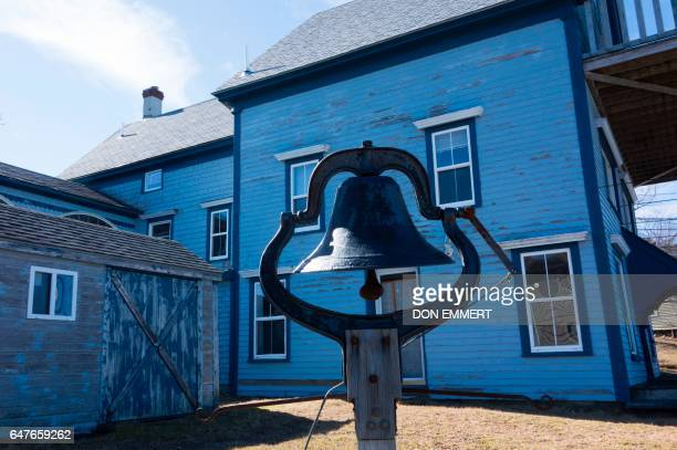 A bell is mounted along the shore near some of the old homes March 3 2017 in Lubec Maine Lubec is the easternmost town in the contiguous United...