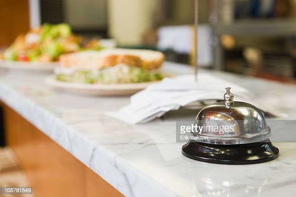 Bell on counter in restaurant