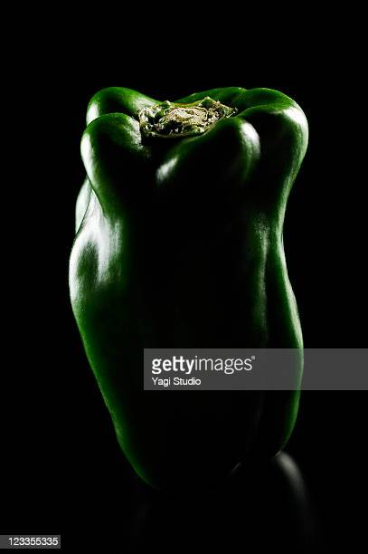 Bell pepper is illuminated black background
