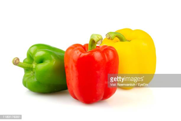 bell peppers against white background - green bell pepper stock pictures, royalty-free photos & images