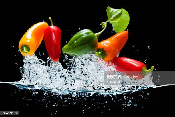 Bell peppers jump out from water.