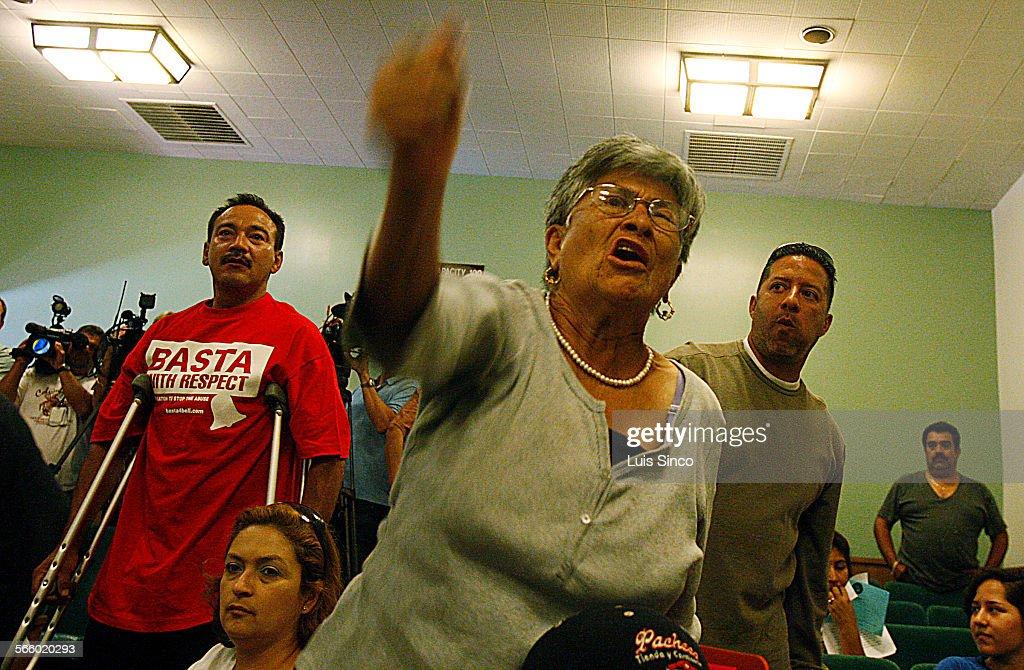 BELL, CALIF. – SEPT. 3, 2010. Bell residents Sergio Varga, left, Carmen Bella and Willie Aguilar st : News Photo