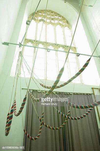 bell ringing ropes inside church tower - richard drury stock pictures, royalty-free photos & images