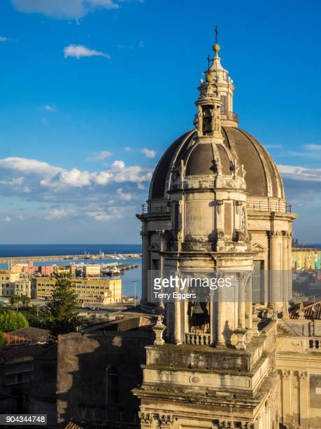 Bell tower and dome of the Roman Catholic Metropolitan Cathedral of Saint Agatha on Cathedral Square in Catania city, Sicily, Italy.