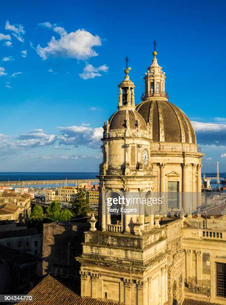 bell tower and dome of the roman catholic metropolitan cathedral of saint agatha on cathedral square in catania city, sicily, italy. - catania stock photos and pictures
