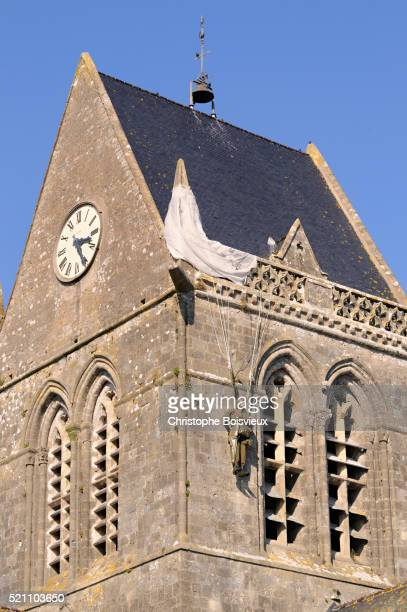 bell tower of sainte-mere-eglise - arromanches stock pictures, royalty-free photos & images