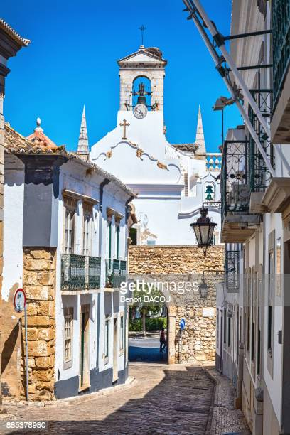 bell tower of the arch, the gateway to the city of faro, algarve region, portugal - faro city portugal stock photos and pictures