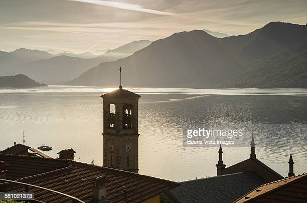 bell tower on lake como at sunrise - como italy stock pictures, royalty-free photos & images