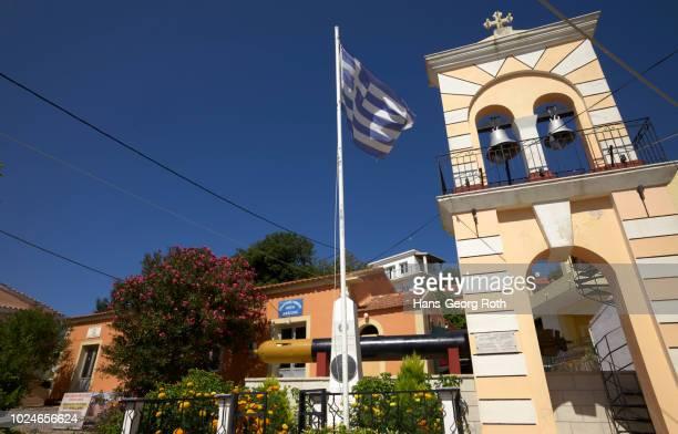 bell tower with greek flag and torpedo - greece wwii stockfoto's en -beelden