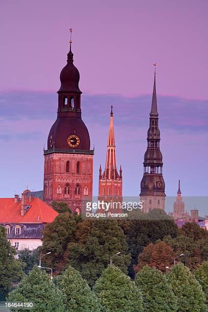 bell towers and spires in riga's old town - unesco stock-fotos und bilder