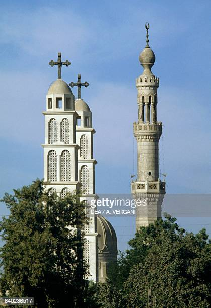 Bell towers of a Coptic Church and a Minaret Kom Ombo Egypt