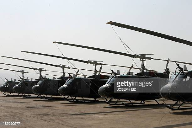 Bell UH1 Huey helicopters sit on the flight line of the Lebanese Air Force base at Beirut Rafic Hariri International airport on November 6 2013 AFP...