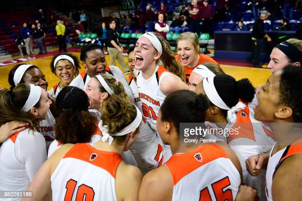 Bella Alarie of the Princeton Tigers elates with her teammates with the win over the Harvard Crimson during an Ivy League semifinal matchup at The...