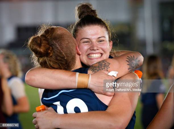 Bella Ayre of the Blues hugs Tilly LucasRodd of the Blues during the 2017 AFLW Round 01 match between the Carlton Blues and the Collingwood Magpies...