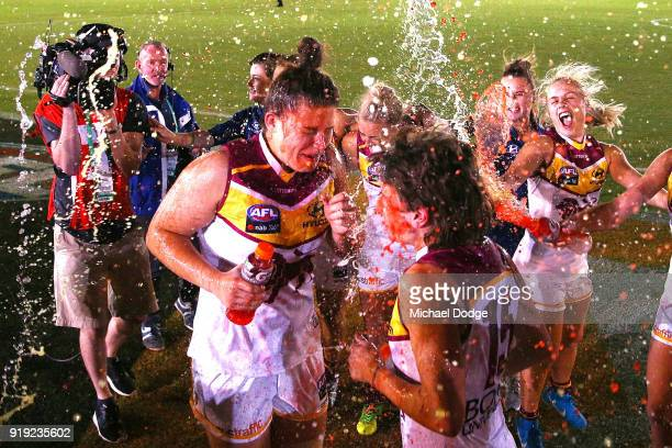 Bella Ayre of the Lions and Nat Exon celebrate the win during the round three AFLW match between the Carlton Blues and the Brisbane Lions at Ikon...