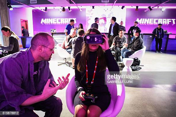 Bella Franco wears Oculus goggles as she gets a press demonstration of the Minecraft for Gear VR at The Village event space in San Francisco...