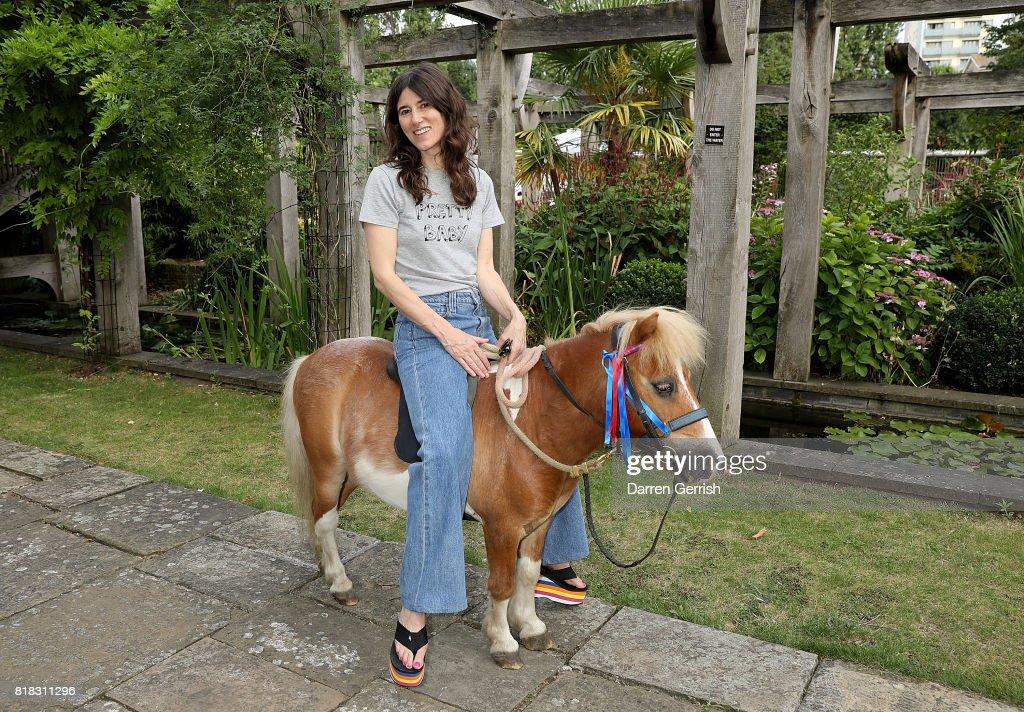 Bella Freud rides Freddie the Shetland pony at the J Brand x Bella Freud garden tea party on July 18, 2017 in London, England.