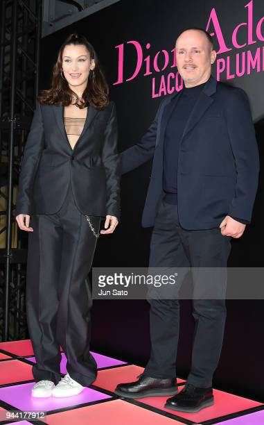 Bella Hadid and Dior creative imaging director Peter Phillips attend the Dior Addict Lacquer Plump Party at 1 OAK on April 10 2018 in Tokyo Japan