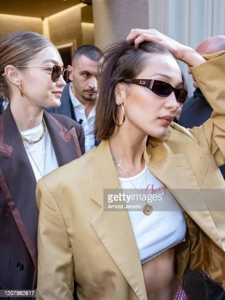 Bella Hadid and Gigi Hadid are seen during Milan Fashion Week Fall/Winter 2020-2021 on February 22, 2020 in Milan, Italy.