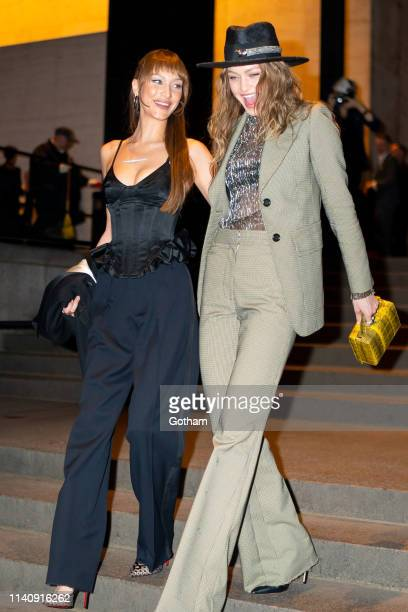Bella Hadid and Gigi Hadid attend Marc Jacobs and Char DeFrancesco's wedding reception at The Grill in Midtown on April 07, 2019 in New York City.