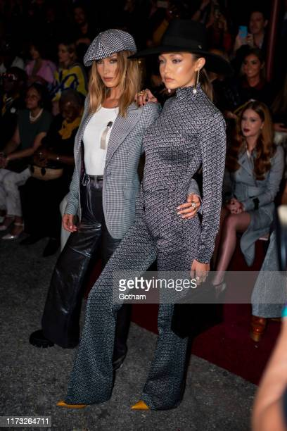 Bella Hadid and Gigi Hadid attend the TOMMYNOW New York Fall 2019 fashion show at The Apollo Theater on September 08, 2019 in New York City.