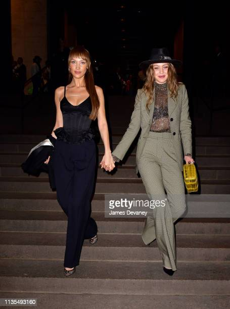 Bella Hadid and Gigi Hadid leave wedding reception for Char Defrancesco and Marc Jacobs at The Grill and The Pool on April 6 2019 in New York City