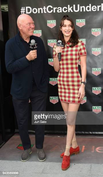 Bella Hadid and Head of Watchmaking of LVMH JeanClaude Biver attend the opening ceremony for Tag Heuer Ginza Boutique on April 9 2018 in Tokyo Japan