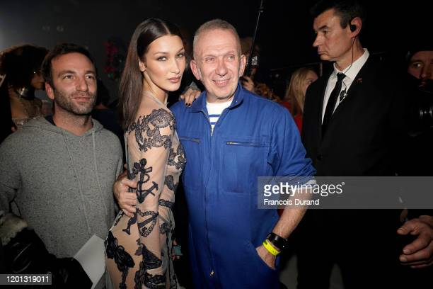 Bella Hadid and JeanPaul Gaultier are seen backstage after walking the runway at the JeanPaul Gaultier 50th Birthday show at Theatre du Chatelet on...