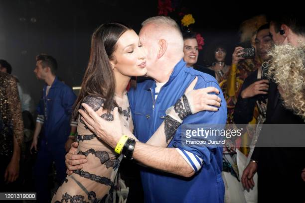 Bella Hadid and JeanPaul Gaultier embrace backstage after walking the runway at the JeanPaul Gaultier 50th Birthday show at Theatre du Chatelet on...