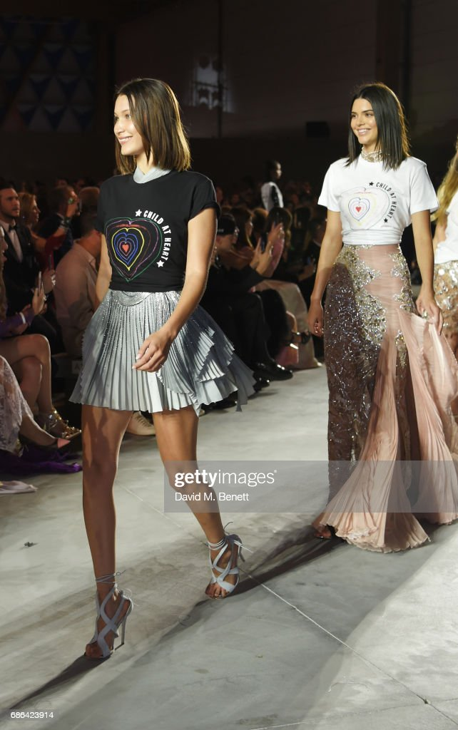 Bella Hadid (L) and Kendall Jenner walk the runway at the Fashion for Relief event during the 70th annual Cannes Film Festival at Aeroport Cannes Mandelieu on May 21, 2017 in Cannes, France.