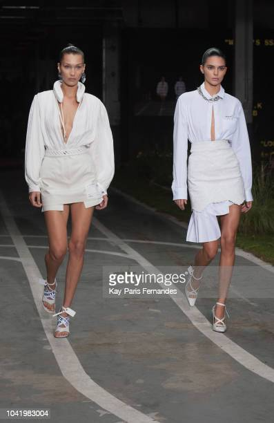 Bella Hadid and Kendall Jenner walk the runway during the OffWhite show as part of the Paris Fashion Week Womenswear Spring/Summer 2019 on September...