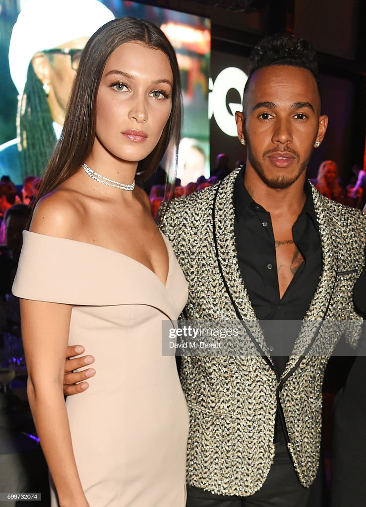 Bella Hadid (L) and Lewis Hamilton attend the GQ Men Of The Year Awards 2016 at the Tate Modern on September 6, 2016 in London, England.