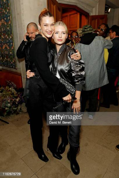 Bella Hadid and Lottie Moss attend Dior_A Magazine Curated By Kim Jones Launch Party at Two Temple Place on May 29 2019 in London England