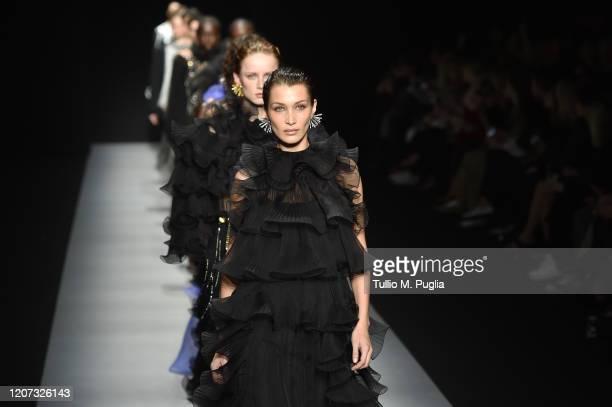 Bella Hadid and models walk the runway during the Alberta Ferretti fashion show as part of Milan Fashion Week Fall/Winter 2020-2021 on February 19,...