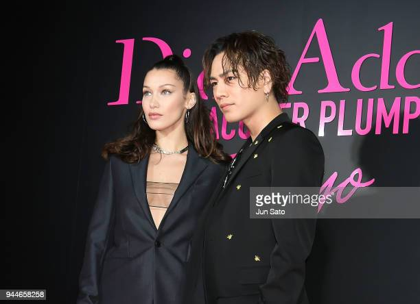 Bella Hadid and Singer Hiroomi Tosaka attends the Dior Addict Lacquer Plump Party at 1 OAK on April 11 2018 in Tokyo Japan