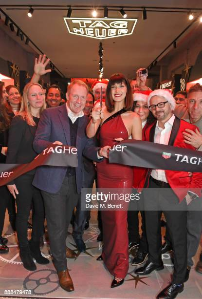 Bella Hadid and TAG Heuer UK Managing Director Rob Diver open the TAG Heuer Flagship Store on Oxford Street on December 8 2017 in London England