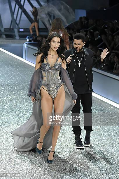 Bella Hadid and The Weeknd are seen together on stage during the Victoria's Secret Fashion Show on November 30 2016 in Paris France