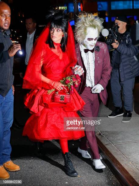 Bella Hadid and the Weeknd dress as Beetlejuice and Lydia when going to Heidi Klum's Halloween party on October 31 2018 in New York City