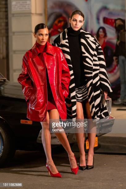 Bella Hadid and Vittoria Ceretti pose for a photo during the Michael Kors Fashion Show at the Booth Theater in Midtown on April 08, 2021 in New York...