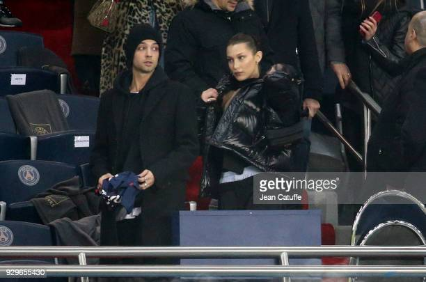 Bella Hadid attends the UEFA Champions League Round of 16 Second Leg match between Paris SaintGermain and Real Madrid at Parc des Princes stadium on...