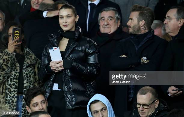 Bella Hadid David Beckham attend the UEFA Champions League Round of 16 Second Leg match between Paris SaintGermain and Real Madrid at Parc des...