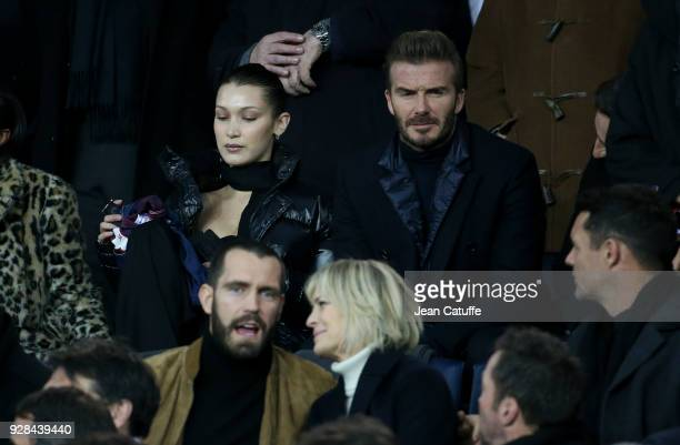 Bella Hadid David Beckham below Robin Wright and Clement Giraudet attend the UEFA Champions League Round of 16 Second Leg match between Paris...