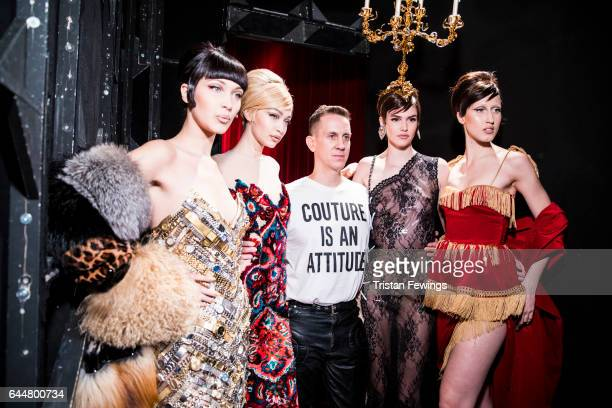 Bella Hadid Gigi Hadid Jeremy Scott a model and Anna Cleveland are seen backstage ahead of the Moschino show during Milan Fashion Week Fall/Winter...