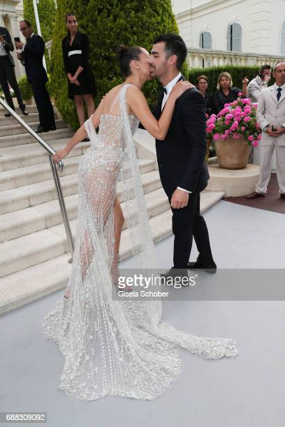 Bella Hadid greets Joe Jonas as they arrive at the amfAR Gala Cannes 2017 at Hotel du CapEdenRoc on May 25 2017 in Cap d'Antibes France