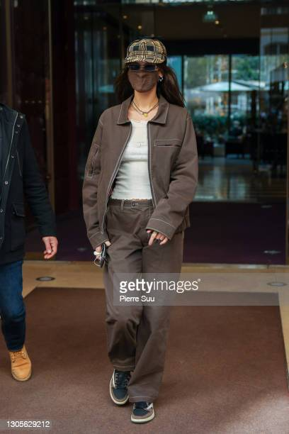 Bella Hadid is seen leaving her Hotel on March 06, 2021 in Paris, France.
