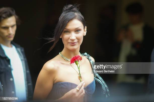 Bella Hadid is seen, outside Balenciaga, during Paris Fashion Week - Haute Couture Fall/Winter 2021/2022, on July 07, 2021 in Paris, France.