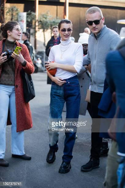 Bella Hadid is seen wearing two tone denim jeans, white turtleneck during Milan Fashion Week Fall/Winter 2020-2021 on February 19, 2020 in Milan,...