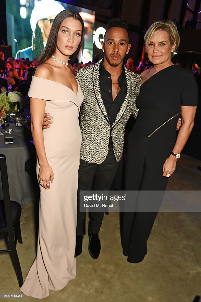 Bella Hadid, Lewis Hamilton and Yolanda Foster attend the GQ Men Of The Year Awards 2016 at the Tate Modern on September 6, 2016 in London, England.