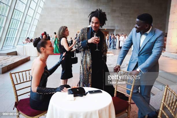 Bella Hadid Luka Sabbat and Daniel Kaluuya attend Heavenly Bodies Fashion The Catholic Imagination Costume Institute Gala at The Metropolitan Museum...